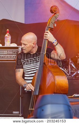 Minsk Belarus-August 12 2017: Bass Guitarist and Contrabass Player Markus Bodenseh of World Renowned Jazz Ensemble De-Phazz Performing at A-Fest Music Festival on August 12 2017 in Minsk Republic of Belarus.