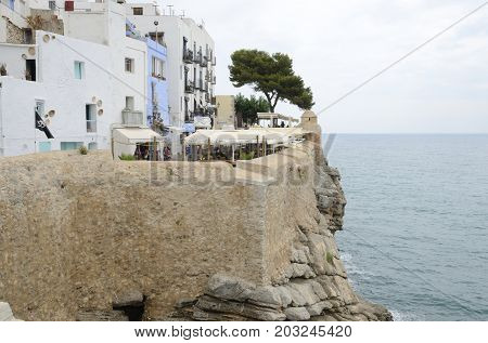 PENISCOLA, SPAIN - JULY 23, 2017: Fortress on a rocky headland in the village of Peniscola Castellon Spain.