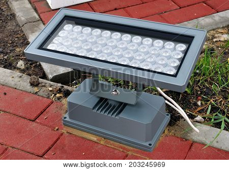 Modern economical led street lighting apparatus mounted on a paving slab