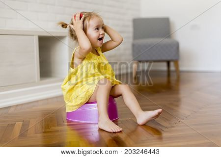 Little Girl On The Potty