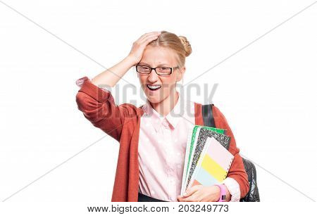 Annoyed Young Student Girl Holding Books.  Back To School
