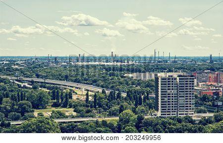 Slovnaft refinery in Bratislava Slovakia. Pollution theme. Factory chimneys. Blue photo filter.