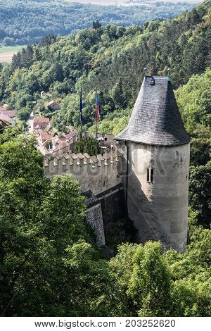 Karlstejn is a large gothic castle founded 1348 by Charles IV in Czech republic. Ancient architecture. Vertical composition.