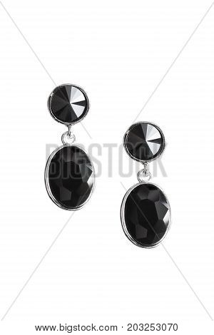 Elegant black obsidian earrings isolated over white