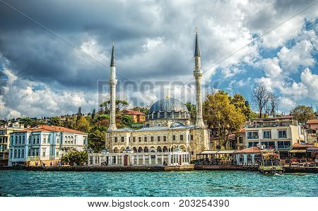 ISTANBUL, TURKEY : Beylerbeyi Mosque by the Bosphorus channel on October 2, 2014