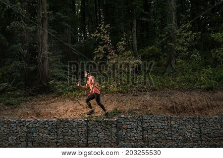 One Young Adult Man Jump, Wilderness, Jungle Portrait, Sport Clothes, Outdoors Nature Forest
