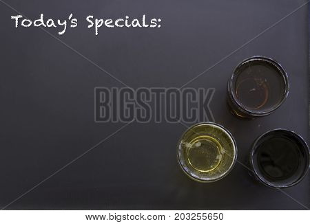Beer Glasses On Chalkboard With Todays Specials