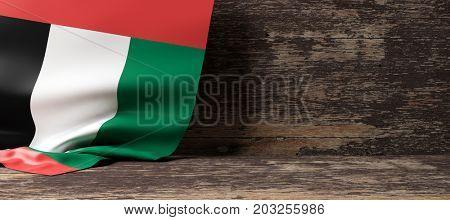 United Arab Emirates flag on a wooden background. 3d illustration