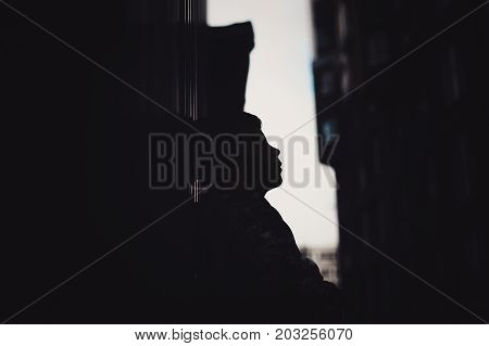 Pre-teen Boy On A Street In A Big City Next To A High-rise Building Alone.