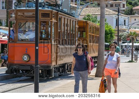 Port De Soller Spain - June 02 2016: Vintage train tram on the beach promenade of the town of Soller in Spain. Opened in 1913 the driving distance is about 5 km long.