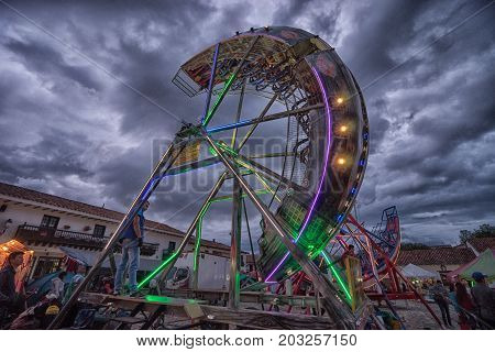July 14 2017 Villa de Leyva Colombia: fairground ride at night at the annual fiesta of the town during 'Honor a La Virgen del Carmen' celebration