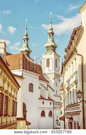St. Michael church in Brno Moravia Czech republic. Religious architecture. Vertical composition. Yellow photo filter.