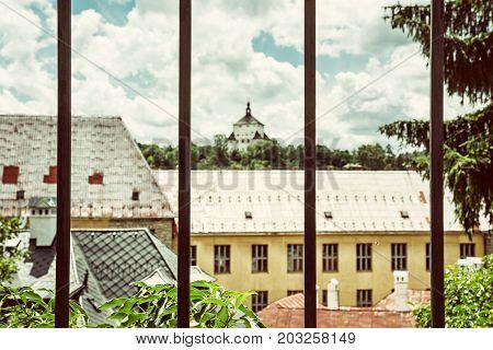 New castle behind a metal fence Banska Stiavnica Slovak republic Unesco. Architectural theme. Travel destination. Cultural heritage. Old photo filter.