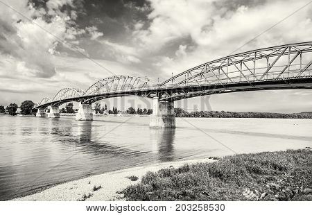 Maria Valeria bridge joins Esztergom in Hungary and Sturovo in Slovak republic across the Danube river. Transportation theme. Black and white photo.
