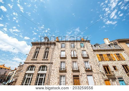Old buildings in the central square of saint Flour town in Cantal region in France