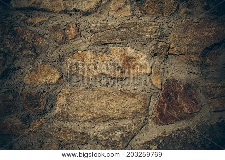 Old stone wall texture and background in vintage style. Old vintage stone wall for graphic design. Close up view of old wall texture and background. Abstract texture and background for designers.