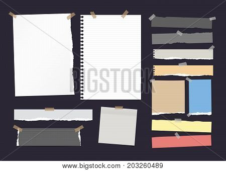 Torn ruled note, notebook, copybook paper strips, sheets stuck with sticky tape on dark background