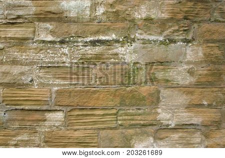 ancient weathered brick wall with visible striations