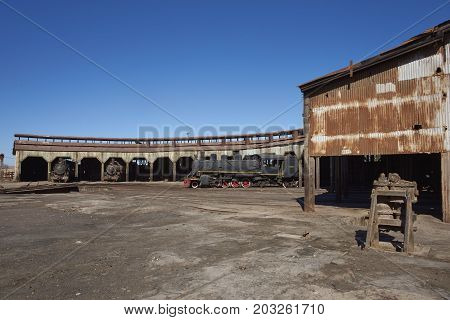Baquedano, Antofagasta Region, Chile - August 19, 2017: Old steam locomotives at the historic engine shed at Baquedano Railway Station in the Atacama Desert, Chile