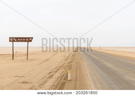 CAPE CROSS NAMIBIA - JUNE 29 2017: Directional sign to Sarah Se Gat a well known fishing spot on the Skeleton Coast of Namibia