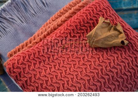 High angle view of dry leaf on sweater at table