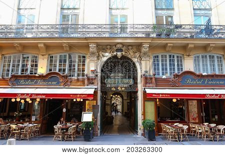 PARIS, FRANCE - AUGUST 23, 2017: Galerie Vivienne is an ancient historical passage with shops and restaurants and a tourist attraction in Paris in France