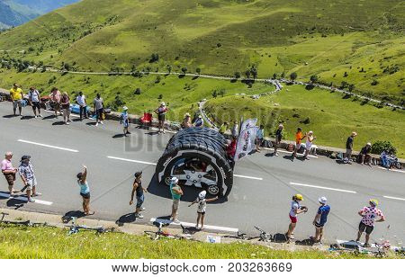 Col de PeyresourdeFrance- July 23 2014: Kleber vehicle passing in the Publicity Caravn on the road to Col de Peyresourde in Pyrenees Mountains during the stage 17 of Le Tour de France 2014.