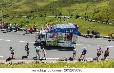 Col de PeyresourdeFrance- July 23 2014: CFTC vehicle passing in the Publicity Caravn on the road to Col de Peyresourde in Pyrenees Mountains during the stage 17 of Le Tour de France 2014.
