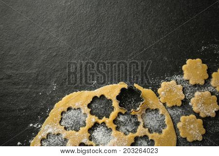 Overhead view of flower shape mould on dough at table