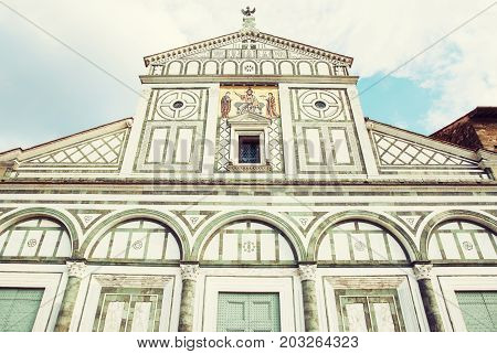 Basilica San Miniato al Monte standing atop one of the highest points in the city. Florence Tuscany Italy. Photo filter. Architectural theme.