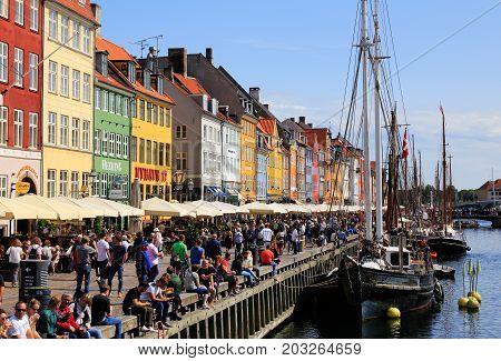 Copenhagen Denmark - August 24 2017: View of the area with restaurants in Nyhavn.