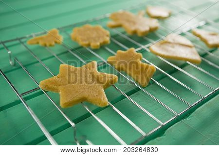 Close up of cookies on cooling rack at wooden table