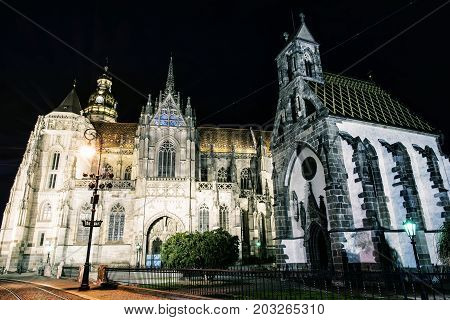 Spectacular St. Elisabeth cathedral and St. Michael chapel in Kosice Slovak republic. Architectural scene. Night photo. Photo filter.