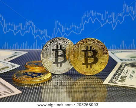 Golden and silver bitcoin on blue abstract finance background. Bitcoin cryptocurrency