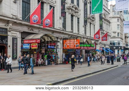 LONDON ENGLAND - JUNE 09 2017: Street view with pedestrians near London Trocadero and Piccadilly circus in London UK