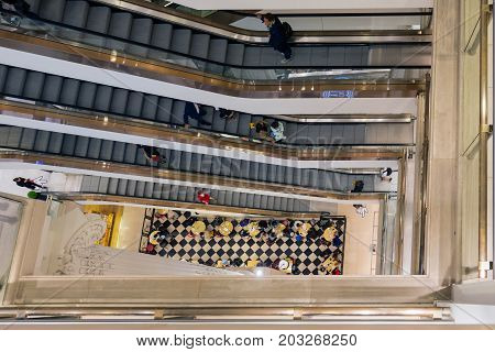 LONDON ENGLAND - JUNE 09 2017: Stairwell with shopping people in famous Selfridges department store London