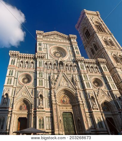 Facade of famous religious and art monument - Duomo Santa Maria Del Fiore and Campanile. Florence, Italy