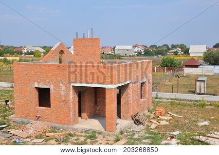 Unfinished Bricks wall house construction with chimney