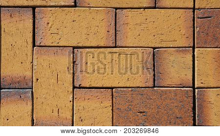 Beautiful Textured Yellow Orange Colorful Luxury German Ceramic Clinker Pavers for Patio. Floor paves in a path detail of a pavement to walk textured background
