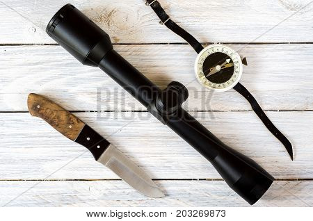Optical Sight, Hunting Knife And Vintage Compass.