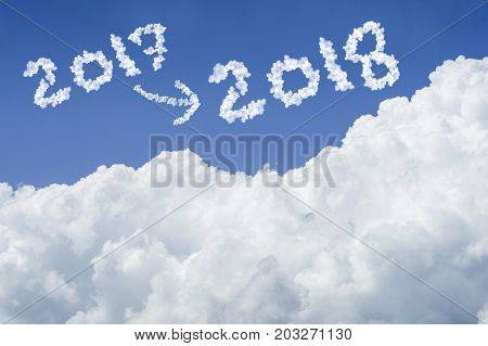 beautiful Blue sky and white cloud. Sunny day. Cloudscape. close up the cloud. text 2017 and arrow change to 2018. end of the 2017 year concept. hope to get a the better life in 2018 concept