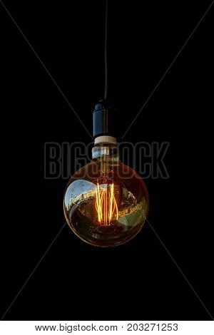 glowing light bulb in a room on a black background