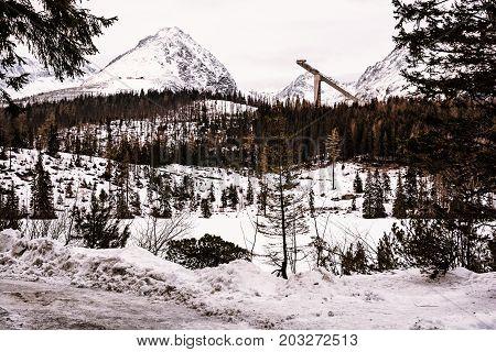 Solisko peak with springboard for ski jumping Strbske pleso Slovak republic. Retro photo filter. Winter mountains.
