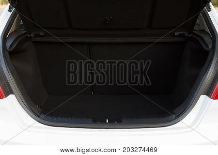 Car with open clean empty trunk close-up