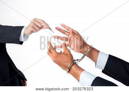 Businessman In Handcuffs And Woman Hand Offering Key Solving Business Ideas Concept Isolated On Whit