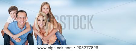 Portrait Of Couple Carrying Their Children's On Their Back Against Sky