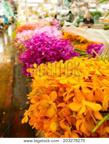 Colorful flowers on sale inside Bangkok flower market Thailand