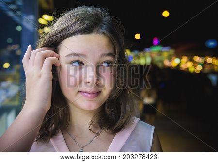 Sad girl teenager outdoors portrait