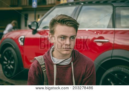 17-18 years old teenager in a city street portrait. Real people. Moscow