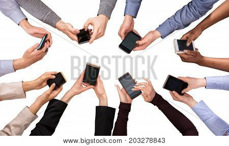 Elevated View Of Hands Using Cell Phone Against White Background